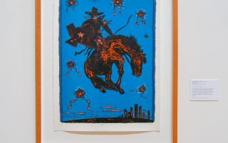 Print of cowboy on bronc horse. City below. State of Texas in foreground.