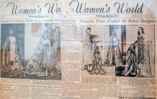 Framed newspaper clippings of an article titled Women's World with pictures of women in Aloha themed dresses