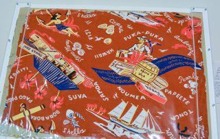 """Original fabric sample showing a woman and a boat anchor, barrels of goods, a man in a straw hat, a hut with a sign that says """"Trader Joe's"""", and a ship"""