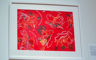 Framed design of palm trees and hibiscus flowers on a red background